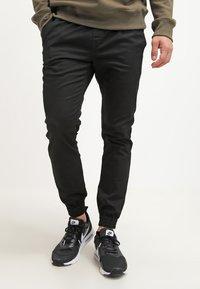 Volcom - FRICKIN SLIM FIT - Trousers - black - 0