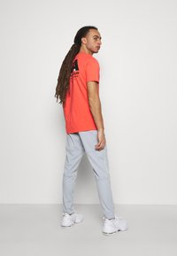 Under Armour - ROCK TRACK PANT - Tracksuit bottoms - mod gray - 2