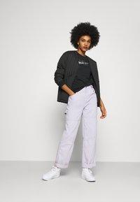 Nike Sportswear - ICON CLASH  - Print T-shirt - black - 1