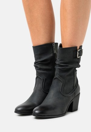 NEW PALAS - Classic ankle boots - black