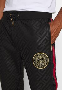 Glorious Gangsta - ALANIS JOGGERS - Tracksuit bottoms - black - 5