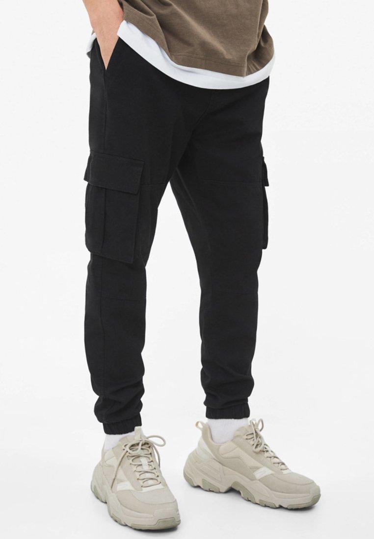 Bershka - MIT GÜRTEL - Cargo trousers - black