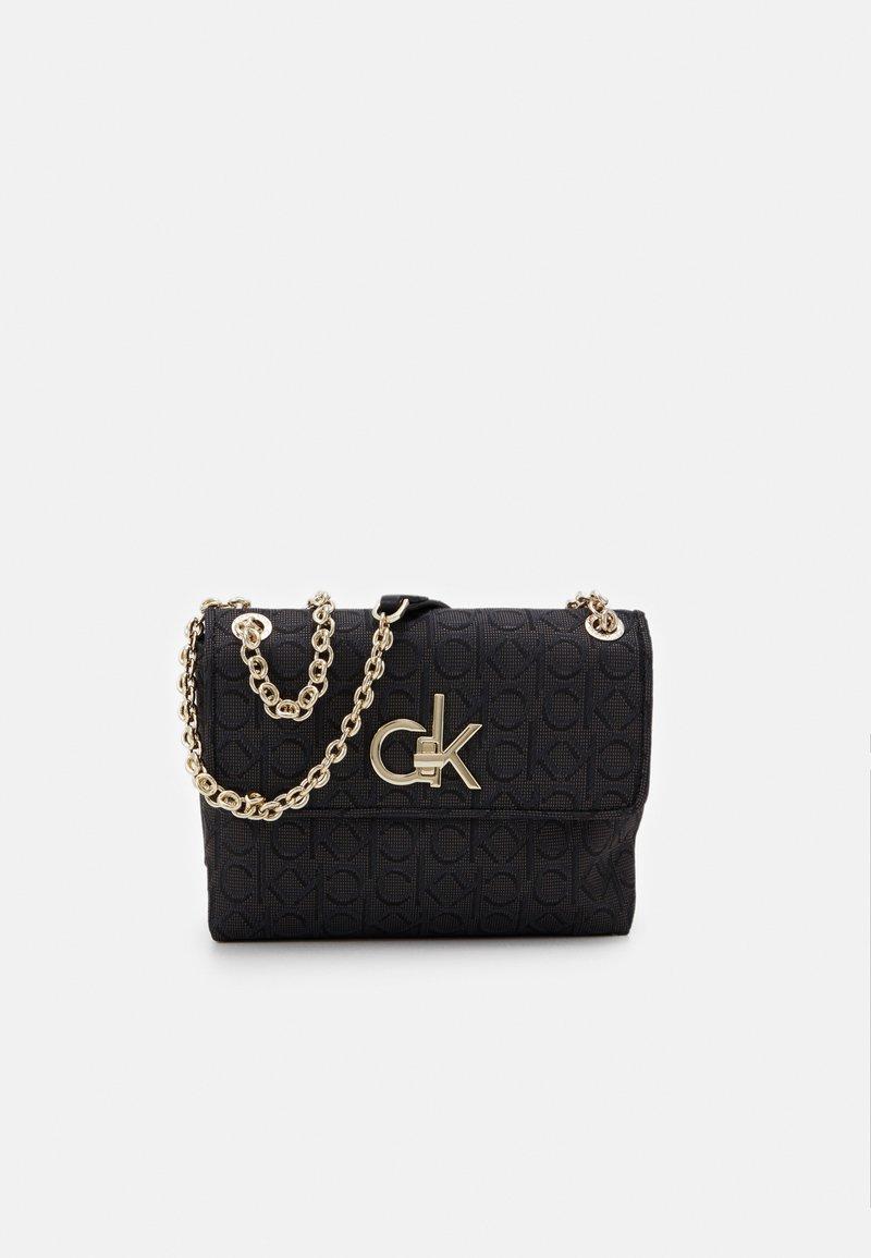 Calvin Klein - RE LOCK CROSSBODY - Torba na ramię - black