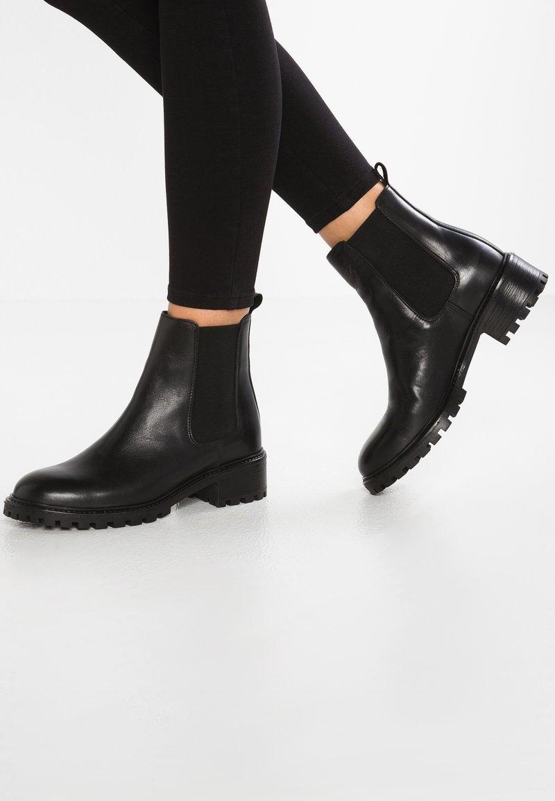 KIOMI - Classic ankle boots - black