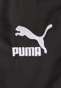 Puma - Tracksuit bottoms - black - 5