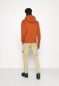 Calvin Klein Jeans - WASHED PANT - Cargo trousers - beige - 2