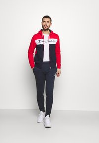 Champion - HOODED FULL ZIP SUIT - Tracksuit - red/dark blue - 1