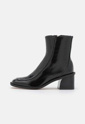 SQUARE - Korte laarzen - noir