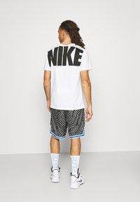 Nike Performance - SEASONAL DNA  - Sports shorts - black/light smoke grey - 2