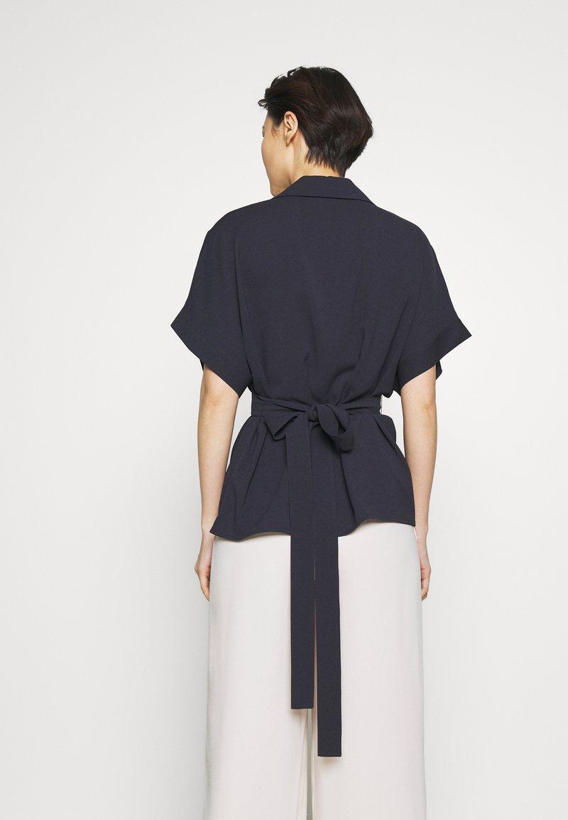 HUGO - CELONA - Button-down blouse - open blue