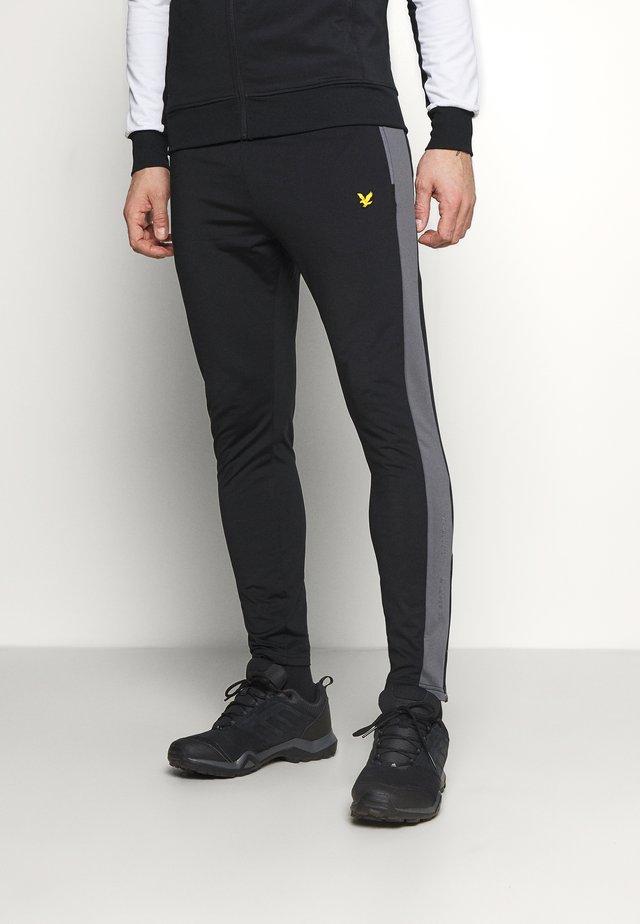 TECH TRACK PANTS - Teplákové kalhoty - true black/rock grey