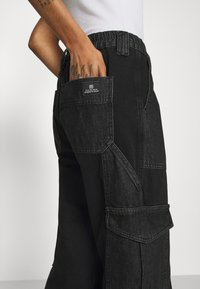 BDG Urban Outfitters - SKATE - Relaxed fit jeans - black/grey patchwork - 5