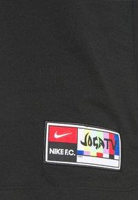 Nike Performance - FC TEE JOGA - T-shirt con stampa - black - 4