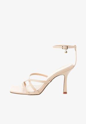 ANDRETTA  - Sandály na vysokém podpatku - beige