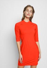 J.LINDEBERG - SAHRA LUX SCULPT - Sportovní šaty - tomato red - 0