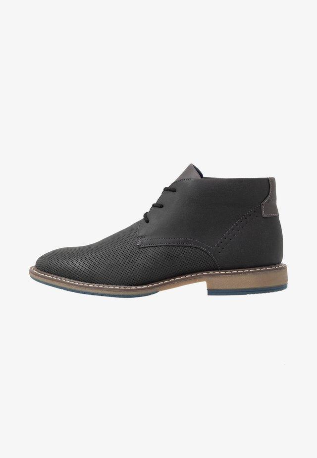 SESTIN - Sportieve veterschoenen - black