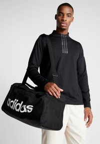adidas Performance - LIN DUFFLE M - Sports bag - black/white - 1