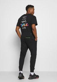 Nike Sportswear - PANT - Verryttelyhousut - black - 2