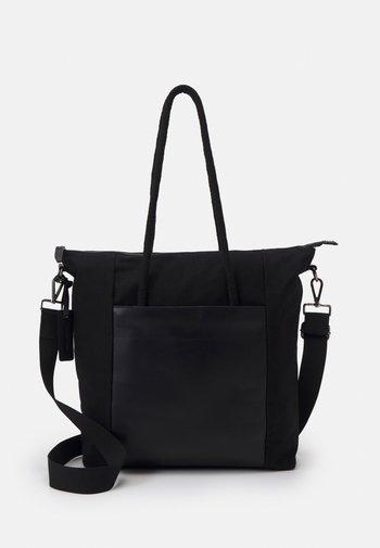 LEATHER UNISEX - Tote bag - black