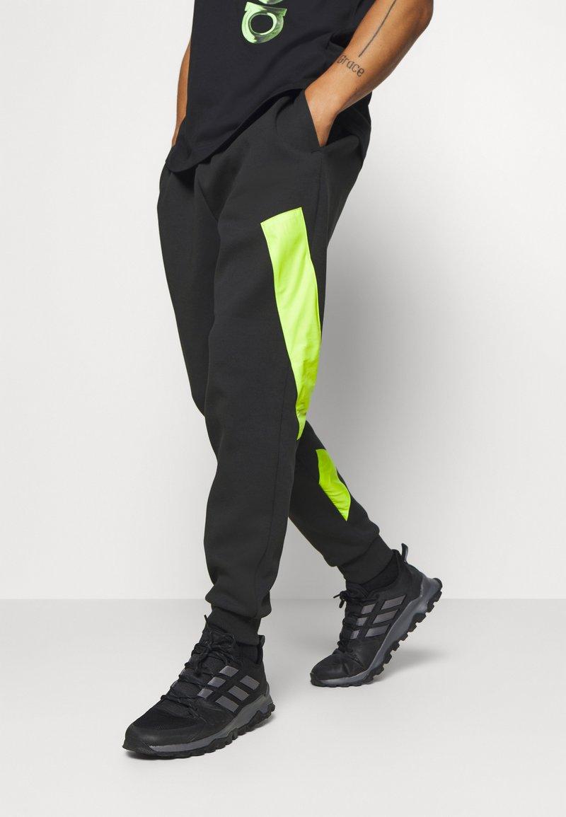 adidas Performance - URBAN PANT - Tracksuit bottoms - black/neon green
