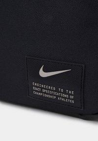 Nike Performance - Wash bag - black/enigma stone - 5