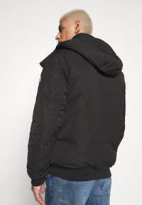 Tommy Jeans - TECH BOMBER UNISEX - Giacca invernale - black - 3