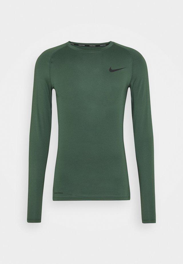 TIGHT - Koszulka sportowa - galactic jade/black