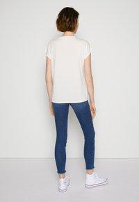 TOM TAILOR DENIM - Basic T-shirt - gardenia white - 2