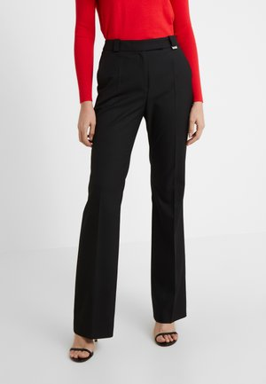 HULARIS - Trousers - black