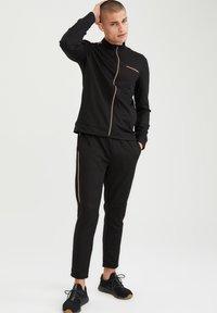 DeFacto - Sweat à capuche zippé - black - 1
