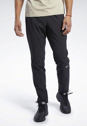 SPEEDWICK TRACKSTER WOVEN PANTS - Spodnie treningowe - black