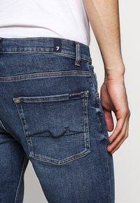 7 for all mankind - REGULAR HEMET - Denim shorts - mid blue - 5