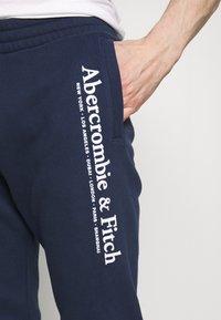 Abercrombie & Fitch - TECHNIQUE LOGO - Pantalones deportivos - navy - 5