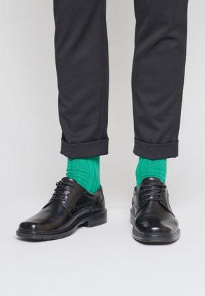 HELSINKI - Zapatos con cordones - black