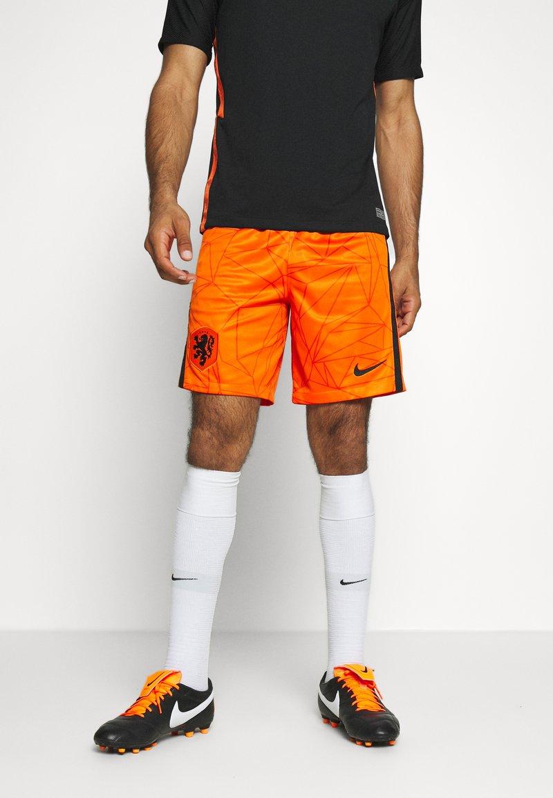 Nike Performance - NIEDERLANDE SHORT - Träningsshorts - safety orange/black