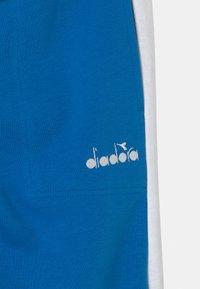 Diadora - CUFF CLUB UNISEX - Tracksuit bottoms - micro blue - 2