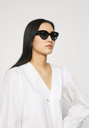 Sunglasses - black on/transparent