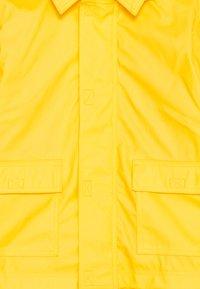 Petit Bateau - BABY CIRE JACKET - Waterproof jacket - jaune - 2