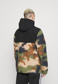 adidas Originals - CAMO WINDBREAKR - Summer jacket - hemp/multco/black - 2