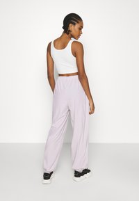 NA-KD - NA-KD X ZALANDO EXCLUSIVE - SPORTY FABRIC PANTS - Tracksuit bottoms - lilac - 2