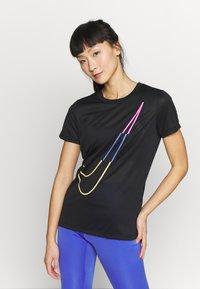 Nike Performance - W NK DRY TEE LEG ICON CLASH - T-shirt print - black - 0