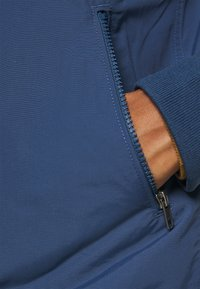 Patagonia - BAGGIES - Outdoor jacket - stone blue