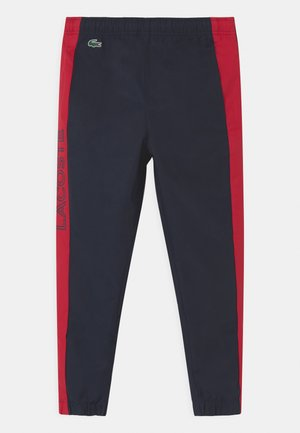 TENNIS UNISEX - Tracksuit bottoms - navy blue/ruby