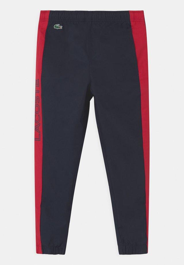 TENNIS UNISEX - Pantalon de survêtement - navy blue/ruby