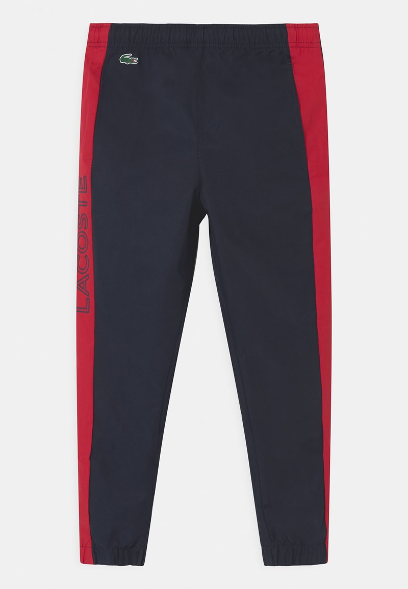 Lacoste Sport - TENNIS UNISEX - Tracksuit bottoms - navy blue/ruby