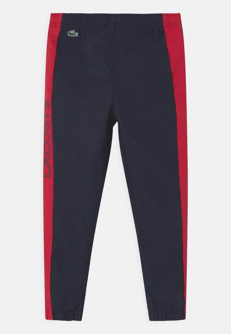 Lacoste Sport - TENNIS UNISEX - Teplákové kalhoty - navy blue/ruby