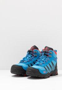 TrollKids - KIDS TROLLTUNGA MID UNISEX - Hiking shoes - medium blue/red - 3