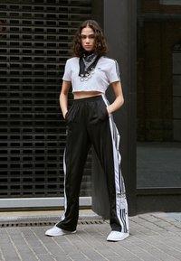 adidas Originals - ADIBREAK PANT - Tracksuit bottoms - black - 5