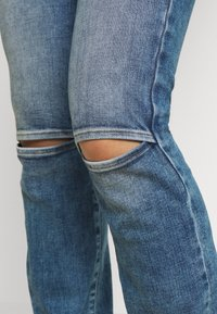 Diesel - D-SLANDY - Bootcut jeans - light blue - 4