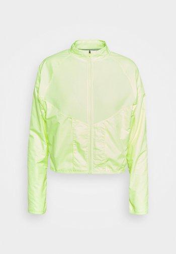 RUN MID - Fleece jacket - barely volt/gold/black